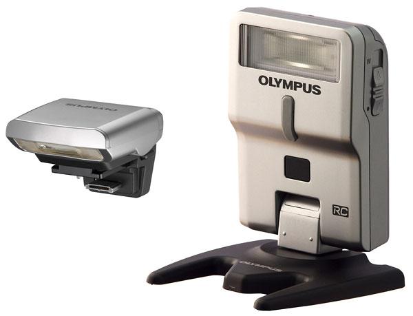 Foto der Blitzgeräte FL-LM1 (links) und FL-300R von Olympus